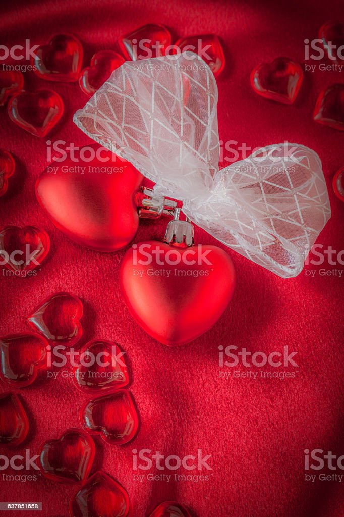 Red Valentine hearts tied together on Satin Cloth (P) stock photo