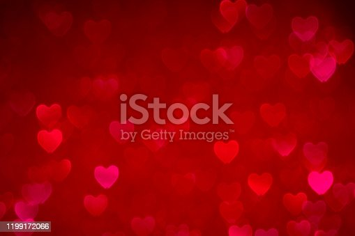 896306118istockphoto red valentines day background with hearts bokeh, love concept wallpaper 1199172066