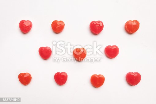 157527860 istock photo Red Valentine's heart shape lollipop candy pastel white background 638724542