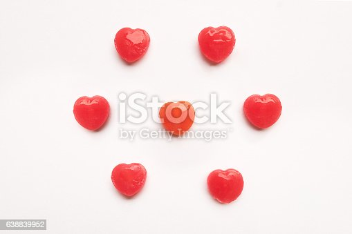 157527860 istock photo Red Valentine's heart shape lollipop candy pastel white background 638839952