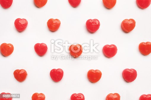 157527860 istock photo Red Valentine's heart shape lollipop candy pastel white background 638839974