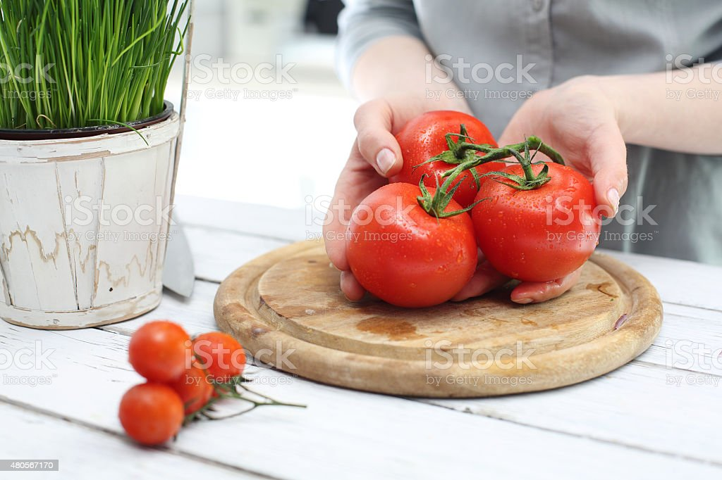 Red vegetables, tomatoes in the kitchen stock photo