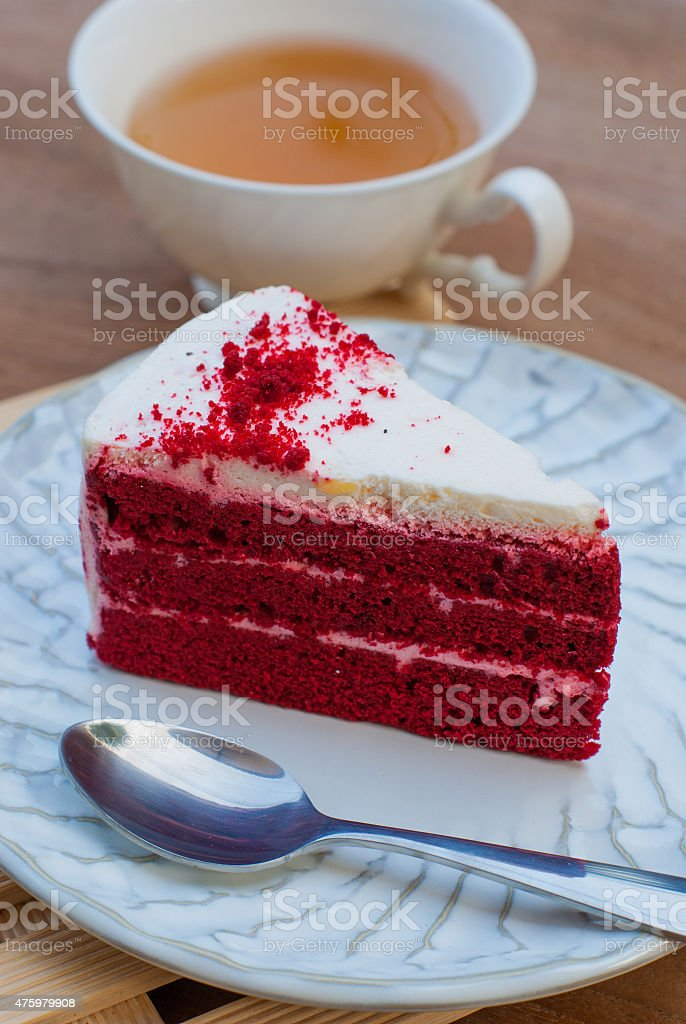 Red velvet cake closeup with cup of tea stock photo