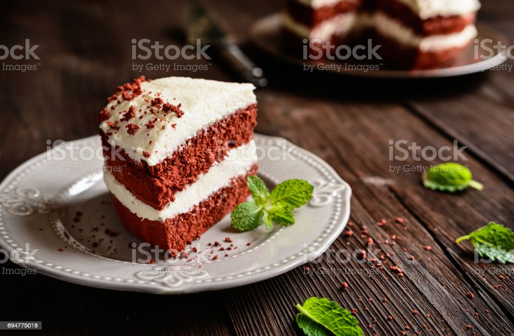 Red velvet cake with whipped cream and mascarpone filling stock photo
