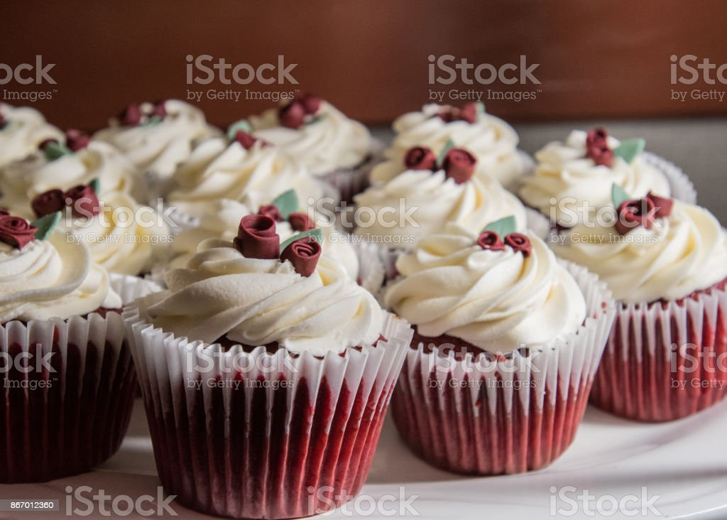 Red Velvet Cupakes with Rose Blossoms stock photo