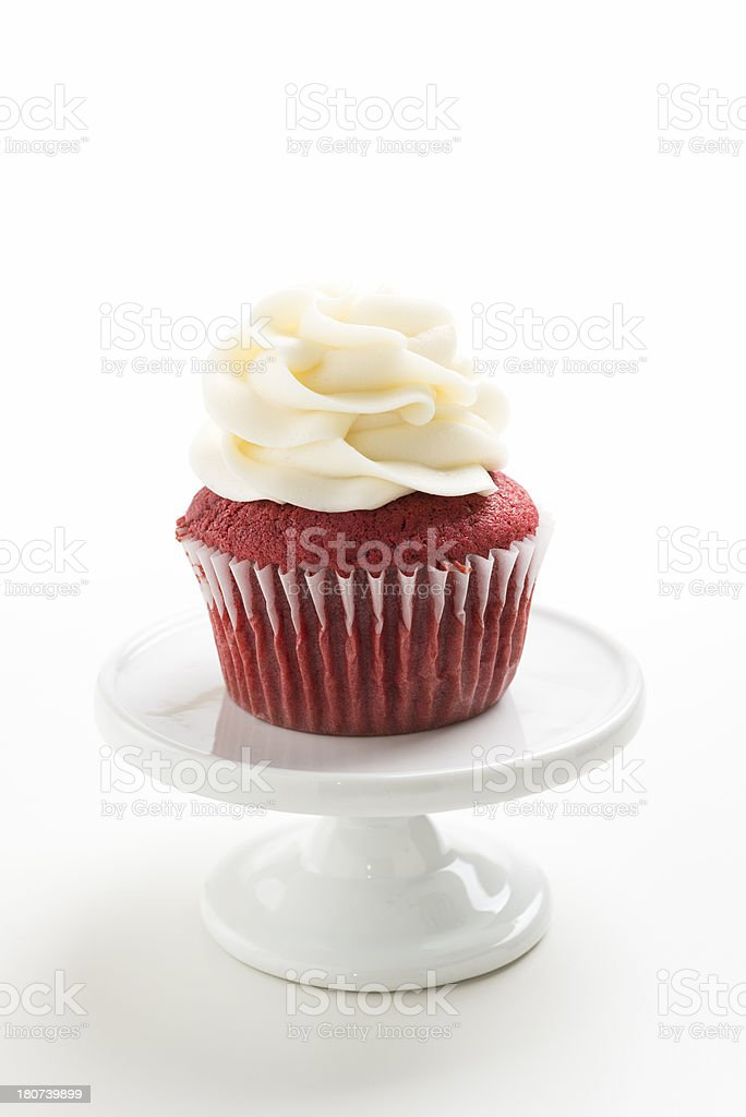 Red Velvet Cupcake on a White Pedestal with Copy Space stock photo