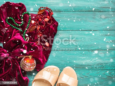 Red velvet dress for Christmas new year party. Decorations fashion accessories banner background. Dressing up concept