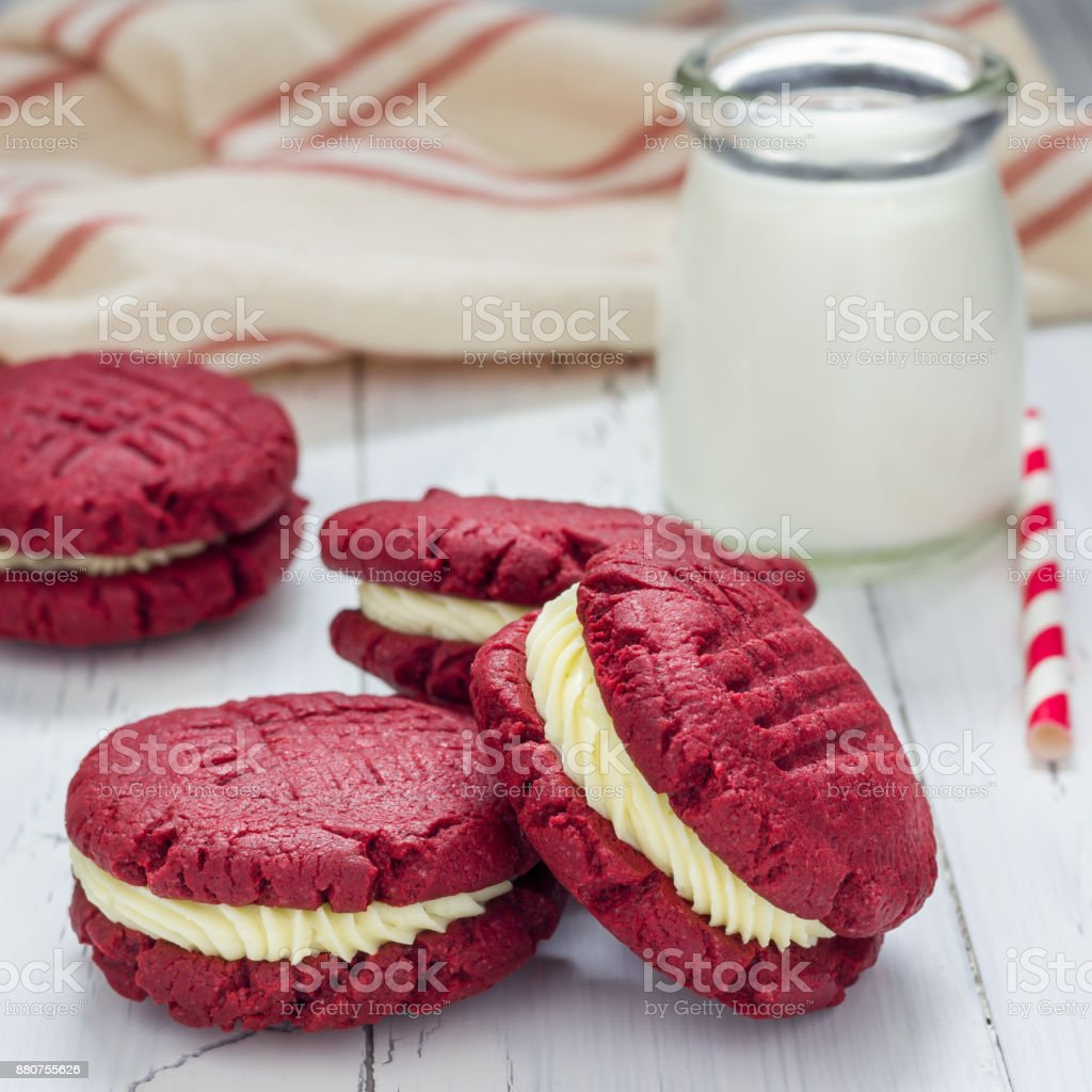 Red velvet sandwich cookies with cream cheese filling, square stock photo