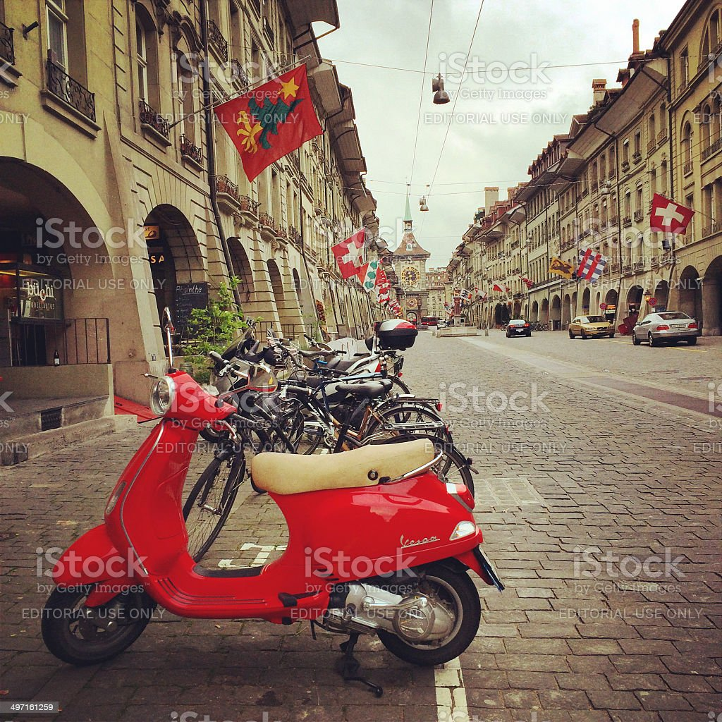Red Vespa parked in old city of Berne, Switzerland stock photo