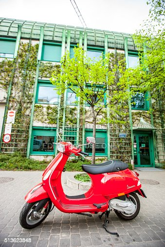 Warsaw, Poland  - April 27, 2015: Red Vespa parked near University Library in Warsaw, Poland