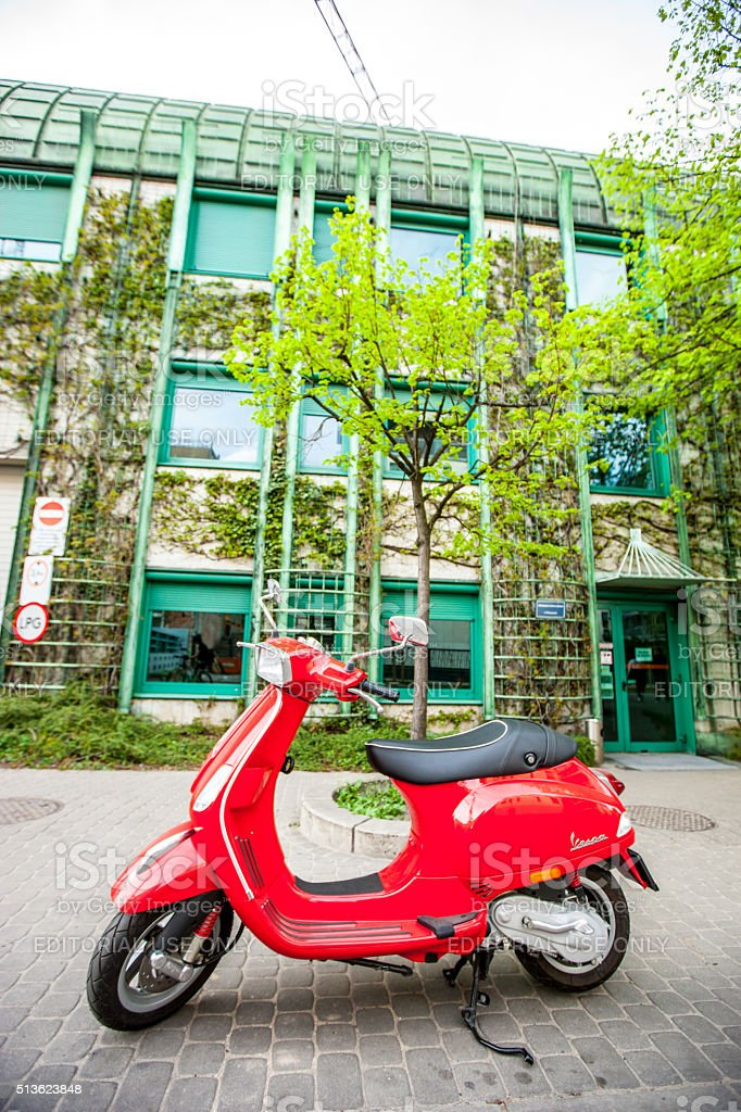 Red Vespa parked near University Library in Warsaw, Poland stock photo