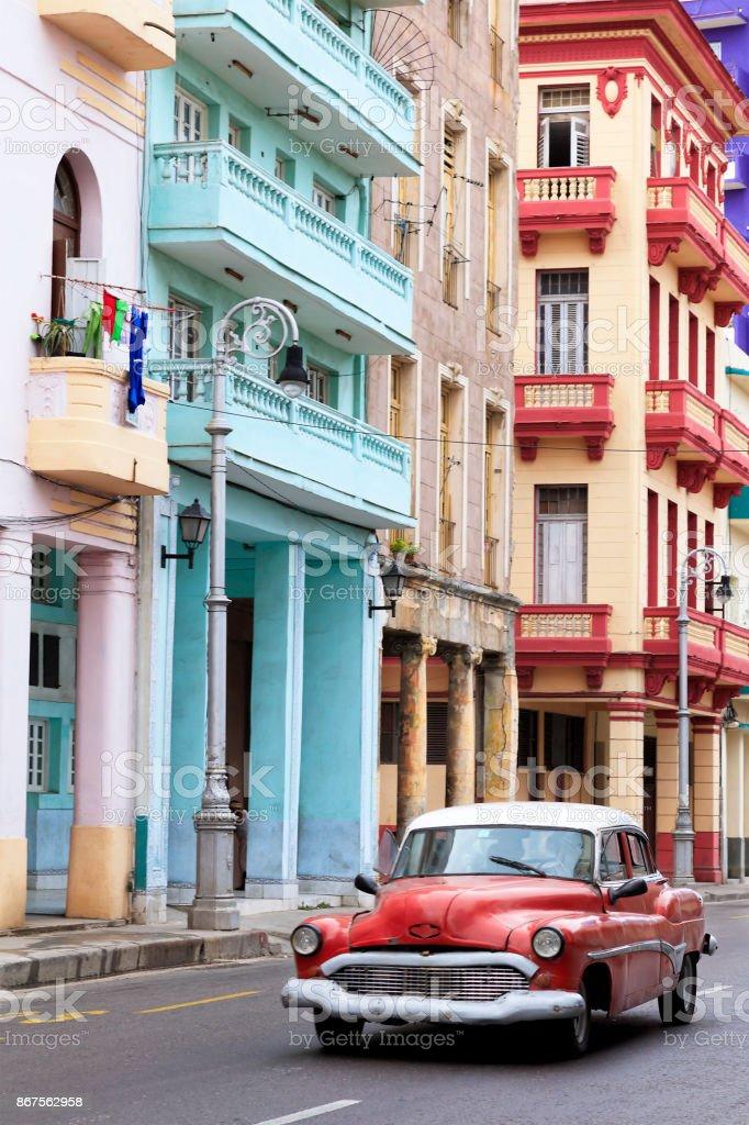 Red Vintage American Car Driving in Havana, Cuba stock photo