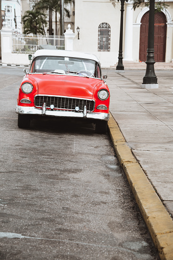 Red Vintage Car In Front Of Lady of the Immaculate Conception Cathedral In Cienfuegos, Cuba