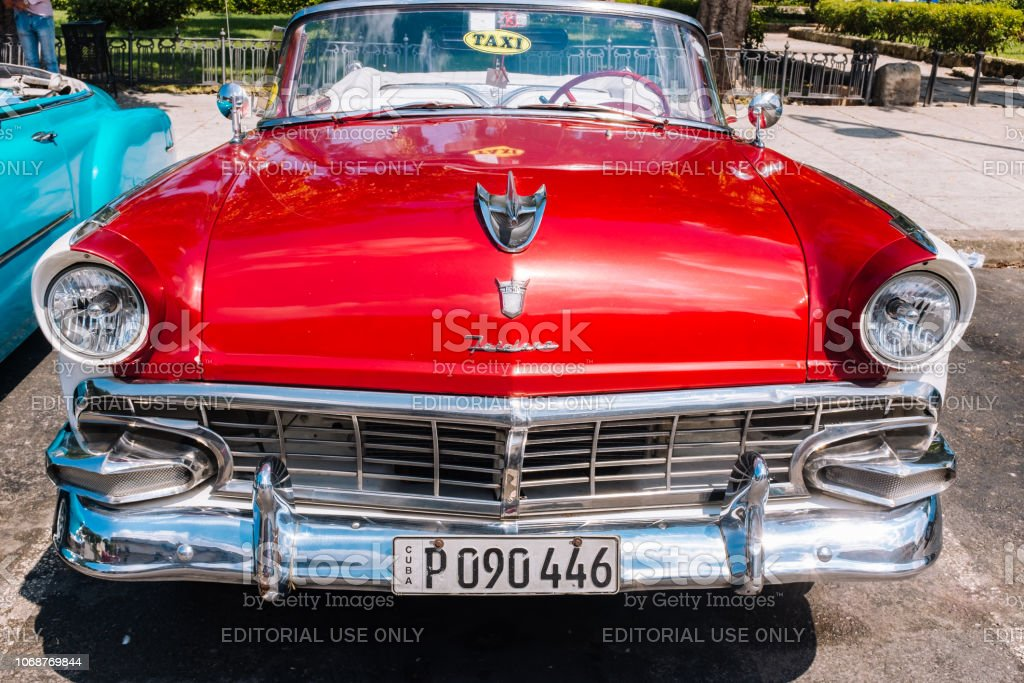 Red vintage car parked in Old Havana, Cuba stock photo