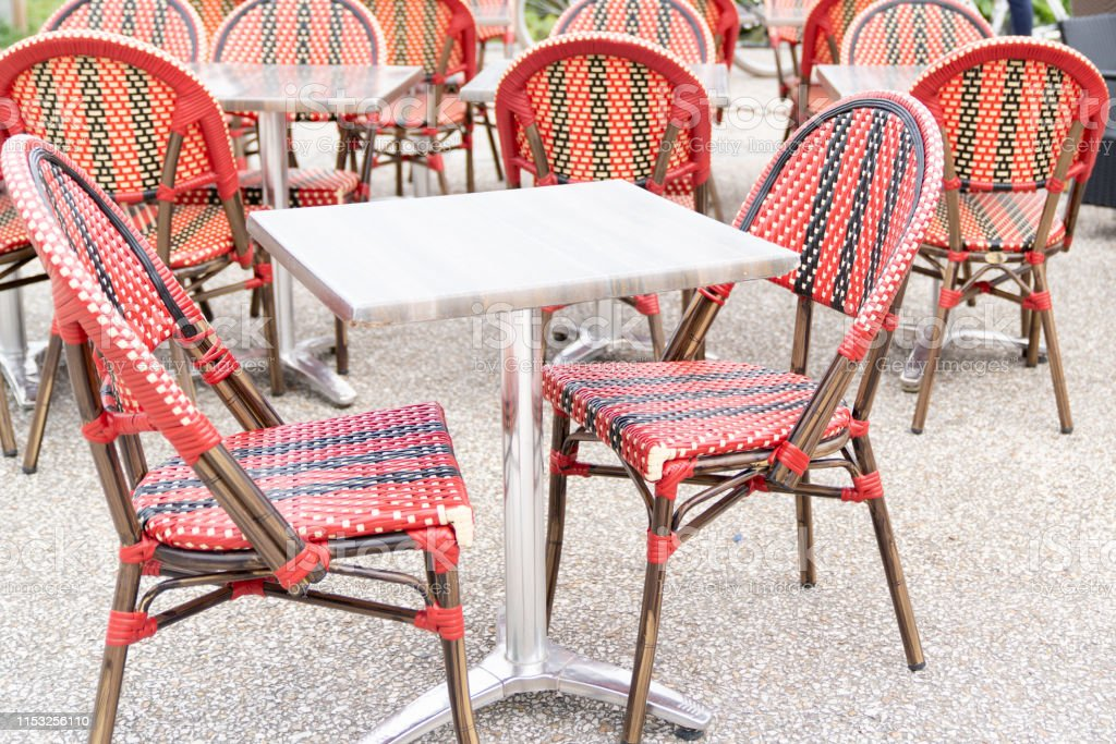 red vintage chairs on the summer terrace outdoor furniture