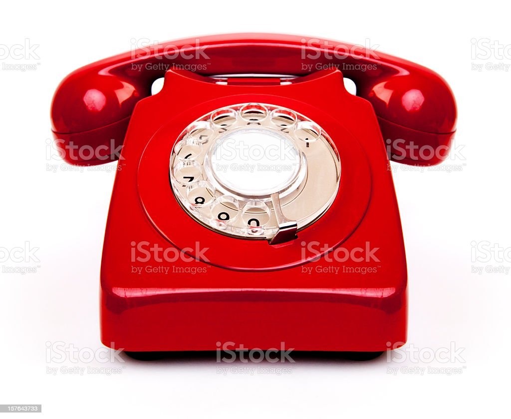A red vintage old school telephone stock photo