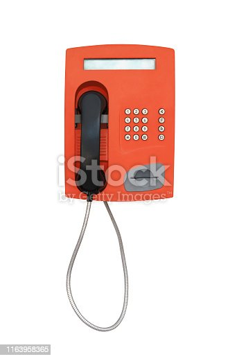 Red vintage payphone for phone cards isolated on white background