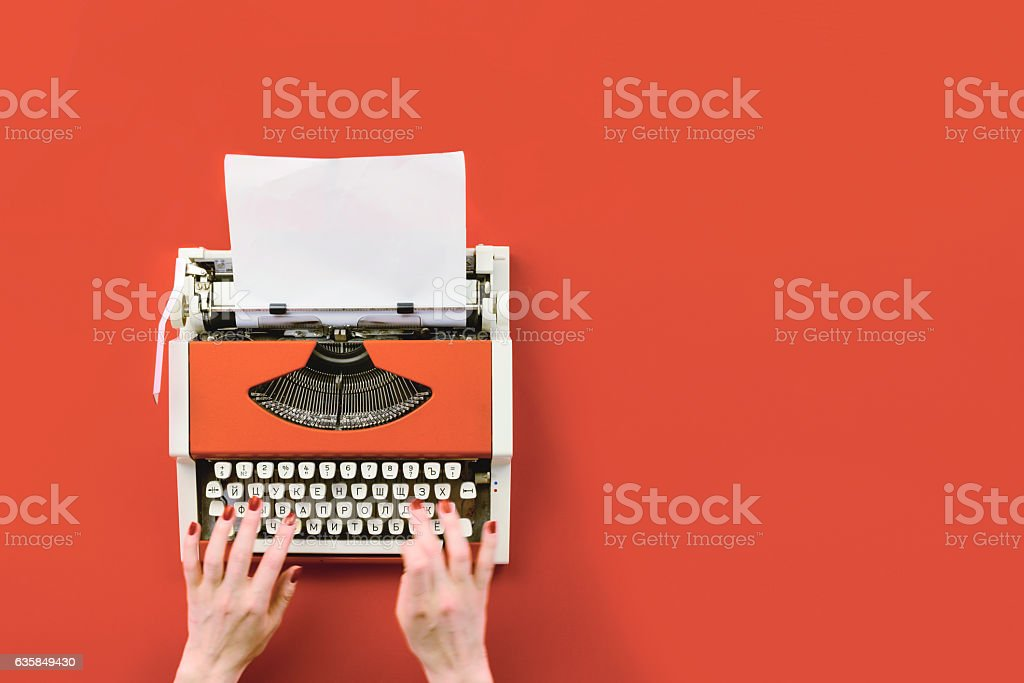 Red vintage typewriter with white blank paper sheet - Photo