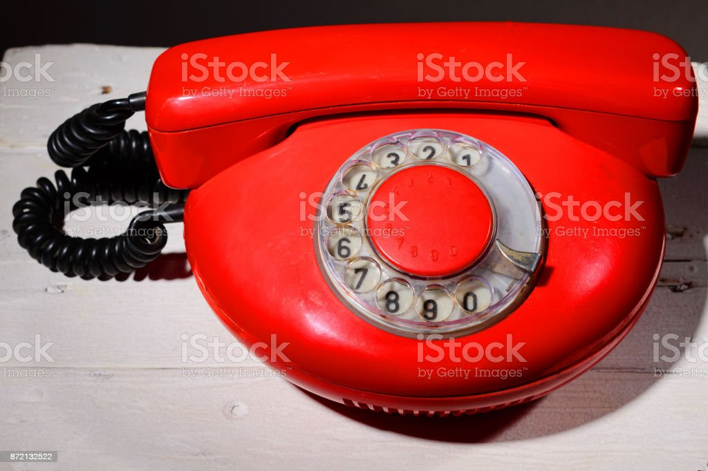 Red vintagephone on white background stock photo