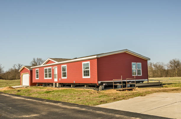 Red Vinyl Siding on New Manufactured Home New manufactured home with red vinyl siding and windows with white lineals manufactured housing stock pictures, royalty-free photos & images