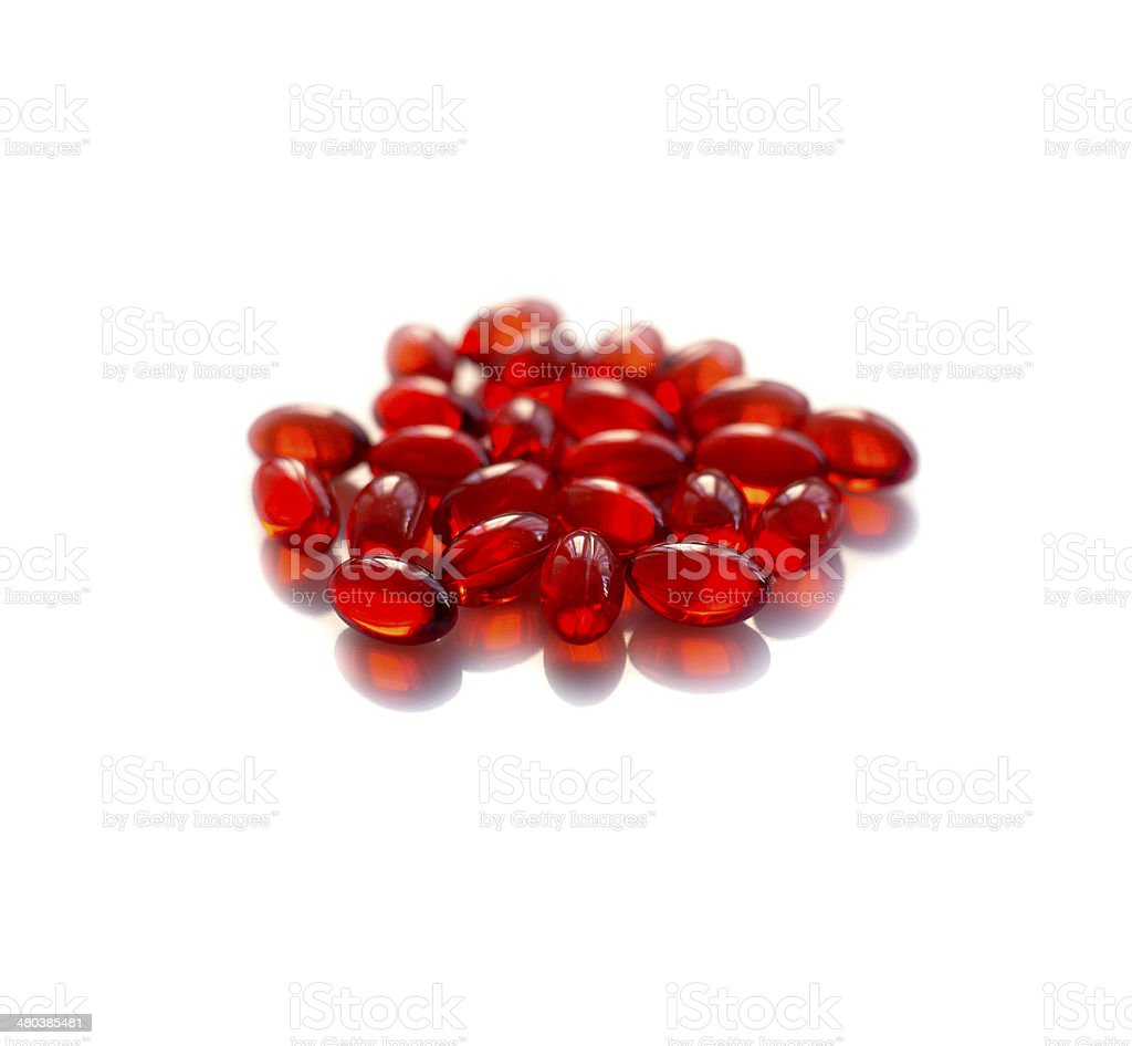 red vitamin e pills isolated stock photo