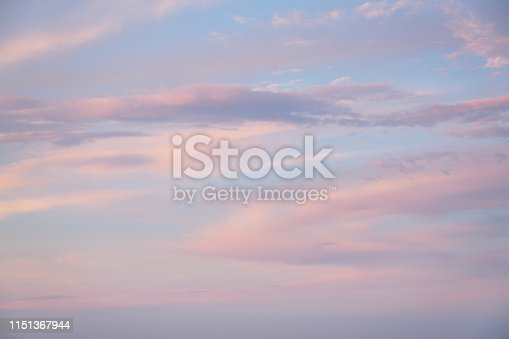 istock Red vivid clouds illuminated by the beam of the sun and dark ominous sky. 1151367944