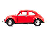 Izmir, Turkey - May 6, 2015: Red Vintage toy Volkswagen car close up image on isolated white background.
