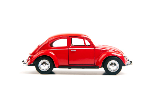 Izmir, Turkey - January 5, 2013: Red Vintage toy Volkswagen car close up image on isolated white background.