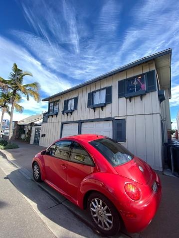 Red Volkswagen parked on a street near Newport Beach, USA