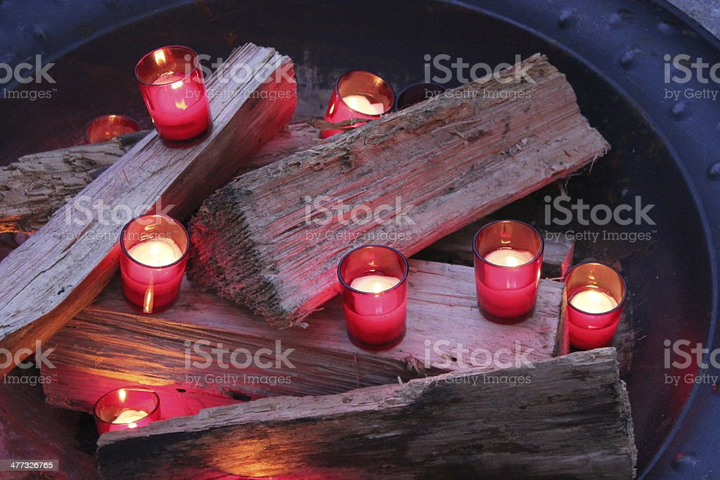 Red Votive Candles in a Firepit royalty-free stock photo