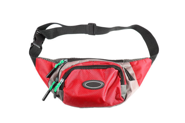 red waist pouch isolated on white background. - waist bag stock photos and pictures