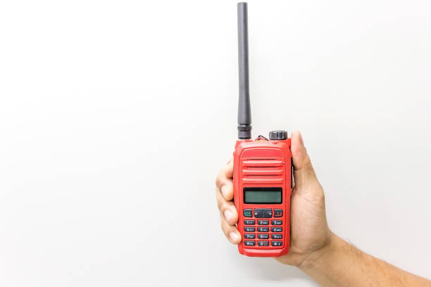 red walkie talkie handheld isolated on a white background - ham radio stock photos and pictures