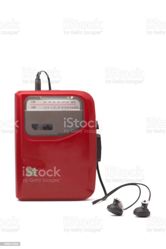 A red Walkman with headphones against a white background stock photo