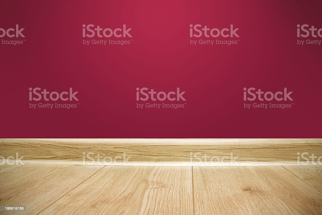 Red wall and wooden floor background royalty-free stock photo