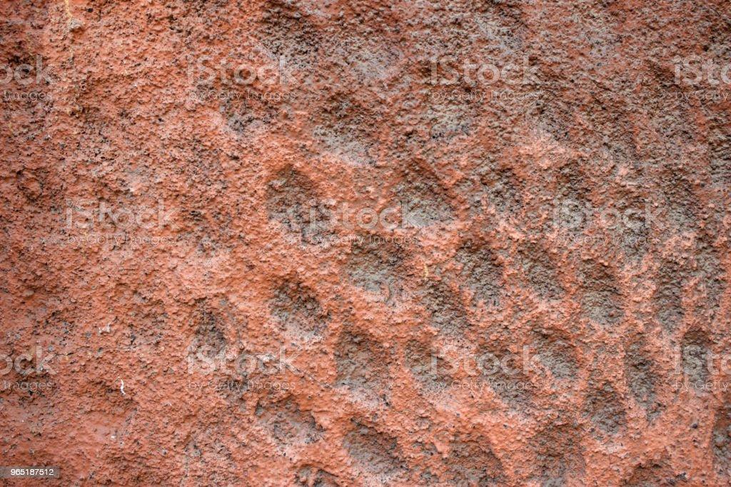 Red wall. Plaster. A rock. Grooves zbiór zdjęć royalty-free