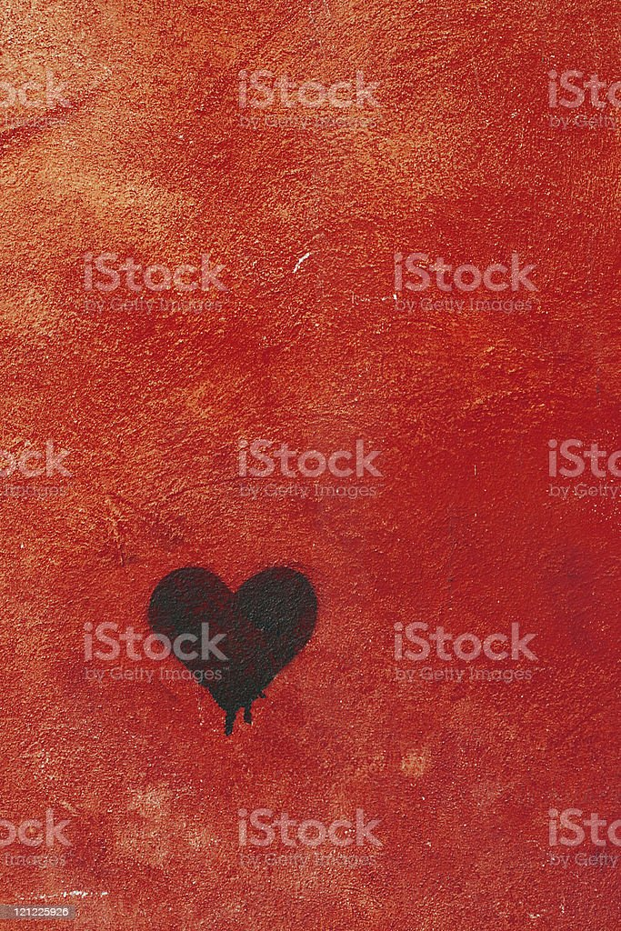 Red wall texture with black heart - Love concept royalty-free stock photo
