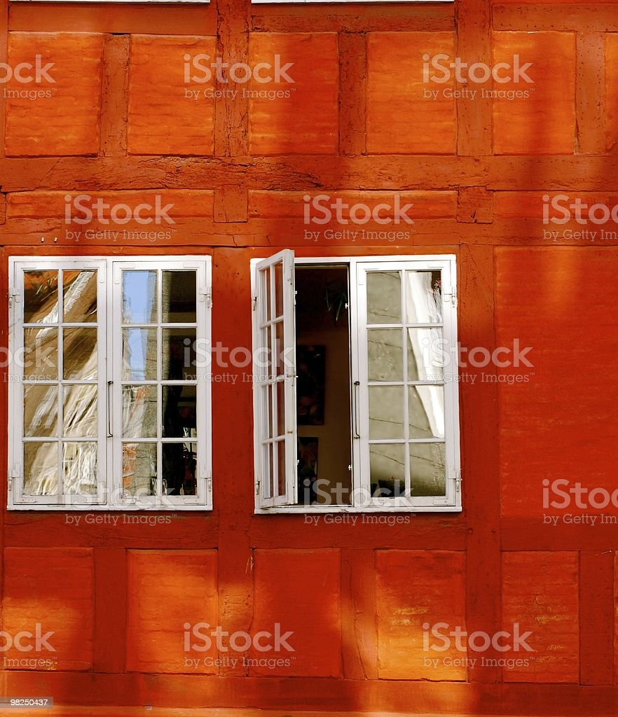 Red wall with open window royalty-free stock photo