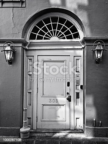 New Orleans, LA USA - May 9, 2018  -  Red Wall Yellow Door Fench Quarter in B&W