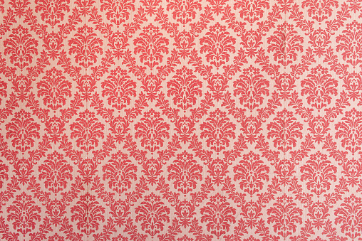 Red wallpaper vintage flock with red damask design on a white background retro vintage style