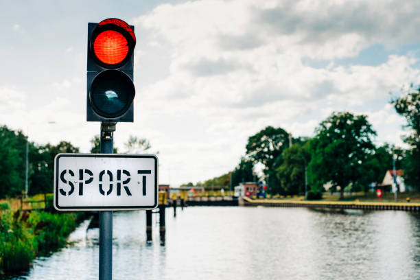 Red warning light on the sports boat dock in front of the sluice stock photo
