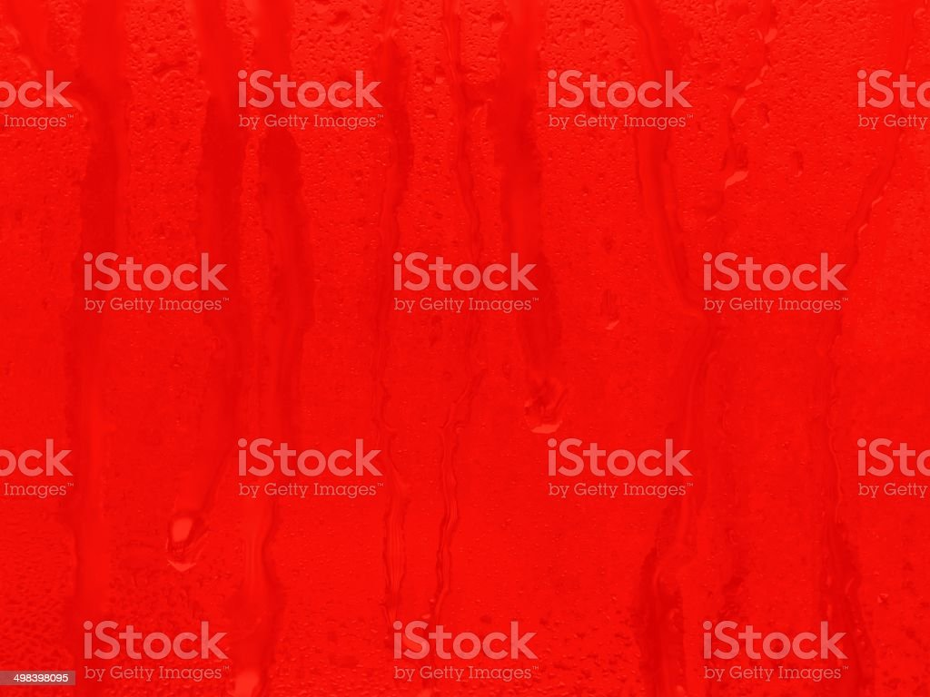Red water drops background stock photo