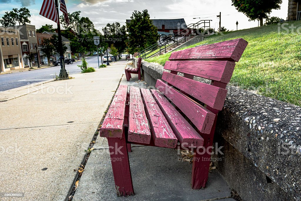 Red weathered park bench royalty-free stock photo