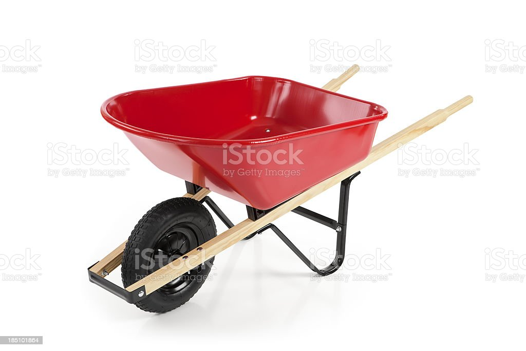 Red wheelbarrow against a white background stock photo