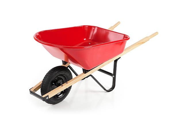red wheelbarrow against a white background - kruiwagen stockfoto's en -beelden