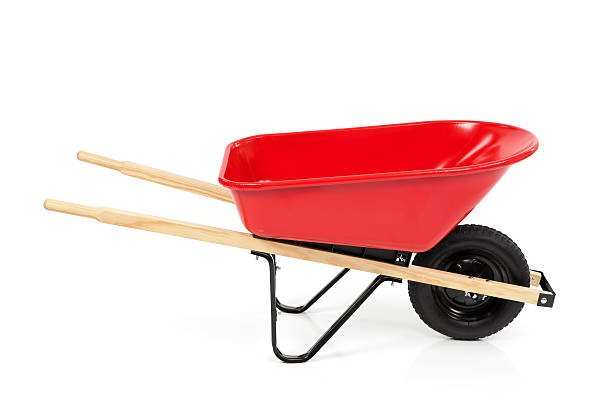 red wheelbarrow isolated - kruiwagen stockfoto's en -beelden