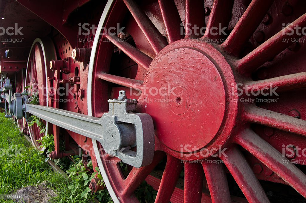 Red wheels of big old steam locomotive from Orient Express stock photo