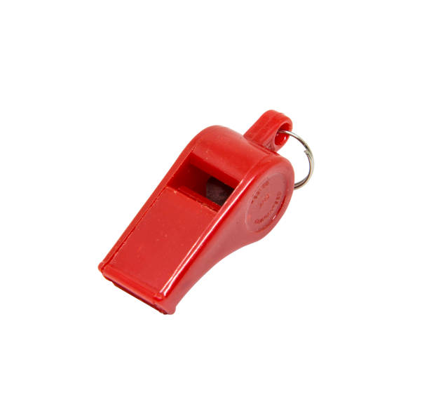 Red whistle on white background stock photo