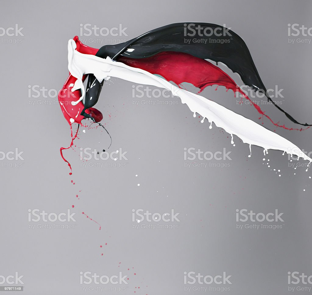 Red, white and black paint colliding stock photo