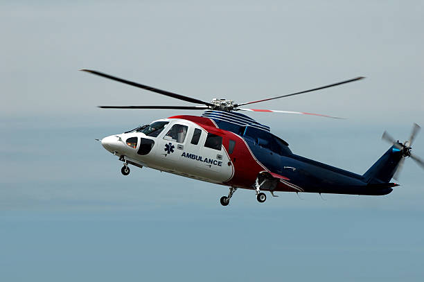 a red, white and blue air ambulance helicopter - emergency response stock pictures, royalty-free photos & images