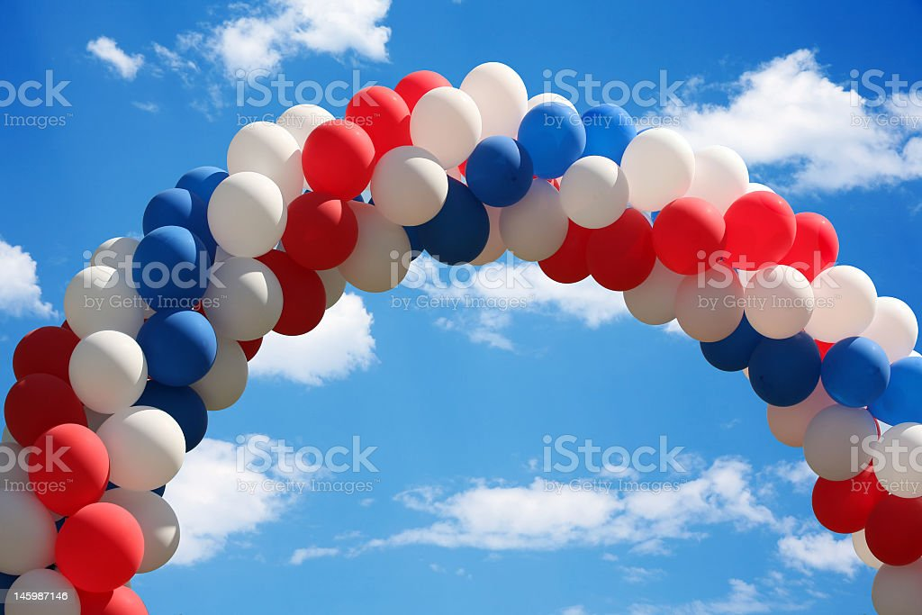 A red white and blue balloon arch stock photo